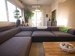 The living room with a large comfortable sofa. Can fit 8 people.