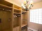 Walk in closet with space for all your needs, featuring, A/C, Ironing board, Iron and cloths hangers