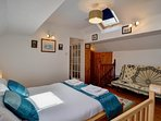 Spacious top floor en-suite bedroom with king size bed and tv/dvd.