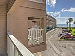 Admire the blue skies and beachy vibes from the condo's balcony!