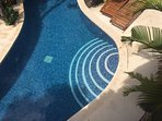 Pool entrance and teak loungers for your relaxtion
