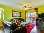 Living room area,, queen sofa sleeper, access to deck. Across from outdoor pool