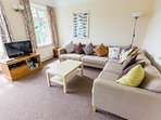Lounge with large corner sofa, Freeview TV and DVD.. Plenty of room to lounge around, or to play