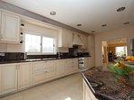 Spacious kitchen with granite worktops