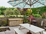 Garden furniture and bbq on the sun patio.