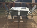 patio talbe & chairs on our south facing decking, a real sun trap with views over Saundersfoot valle