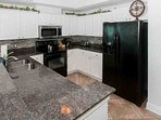 Kitchen with granite counters and tiled backsplash