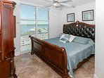 Guest bedroom with king size sleigh bed and lagoon view