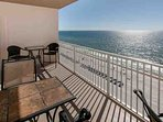 Dining and lounging areas overlooking the beach and the Gulf