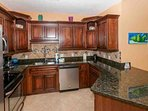 Fully equipped kitchen with tile floors and backsplash