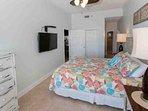 Master bedroom with highboy dresser looking towards master bath