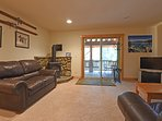 Downstairs is the family room, with a TV and access to the second deck