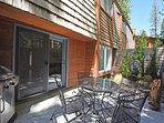 Step outside to enjoy a meal, patio furniture and a BBQ for guest use
