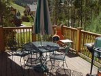 Deck - The deck faces the slopes/mountain! It is large enough for a nice table, a propane grill, as well as a wood...