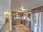 Prepare home-cooked meals in the fully equipped kitchen, complete with stainless steel appliances and granite...