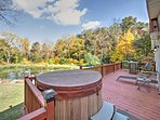 Soak in the hot tub with an expansive view of the property.
