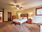 You'll find a rejuvenating rest on the master bedroom's comfy king-sized bed.
