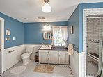 This large, full bathroom resembles a country day spa!