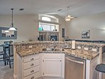 The fully equipped kitchen features granite countertops and stainless steel appliances.