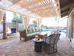 Relax while watching the kids play under the pergola with curtains