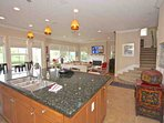Bright kitchen/family room looks out to the golf course
