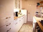 well equipped kitchen with washing machine, dishwasher etc