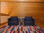 Upstairs loft seating chairs convert to twin sleepers
