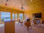 Lower level living area/wet bar and 75' TV