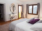 Bedroom 2 with king sized double bed, chaise lounge and ensuite bathroom with bath & walk-in shower,