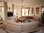 The Villa's sumptuous lounge with sofas, coffee table,  Bang & Olufsen CD player