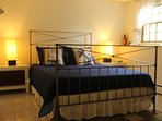 3rd BR downstairs with supper comfy bed and modern furniture.  Linen & towels available for $15pp.