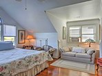 Rest your head on the king-sized bed in the master bedroom.