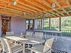 An outdoor dining area and ping pong table add entertainment and space.