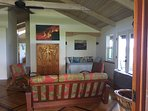 Lovely open beamed living room with Hawaiian art all over the house!