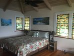 California King bed in the very spacious master bedroom with over head fan, and LOTS of windows!