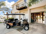 Front of home with concrete parking for 3 cars.  EZ-GO cart is available for rent to take you around