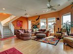Bright and airy living room with space and view. Fireplace, TV and open to kitchen and dining