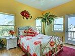 'Tropical Room' on the main floor. Queen bed, deck access, TV and lots of windows. En-suite bathroom