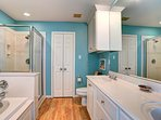Blue Room bathroom with jetted tub, shower, dual sinks and space. Spend a while to relax and renew.