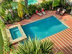 Pool shot.  Pool can be heated in winter. Spa jets feel great!   Tropical foliage with space for all