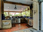 Gas grill, fridge, built in cooler, sink and space to cook and create some masterpieces.