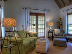 Living room French doors open to the wrap around porch