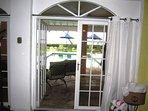 3rd bedroom, (downstairs) doors open  onto the pool deck