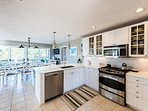 Chef's Kitchen with Quartz Counters, Stainless Appliances, Breakfast Bar