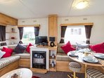Spacious lounge area book this caravan for your holiday.
