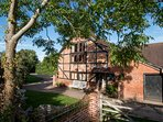 Hoppickers Barn 'RuralRetreat' with outdoor heated swimming pool in the summer