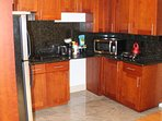 Kitchenette with full-size fridge, microwave, toaster oven, hot plate, & coffee pot