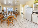 Kitchen, dining, living room with views and access to your private veranda and beach.
