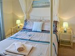 Romantic and relaxing bedroom with four poster bed. Perfect to get away from it all.