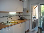 Separate fully-equipped kitchen with access to back garden and outside kitchen for summer cooking